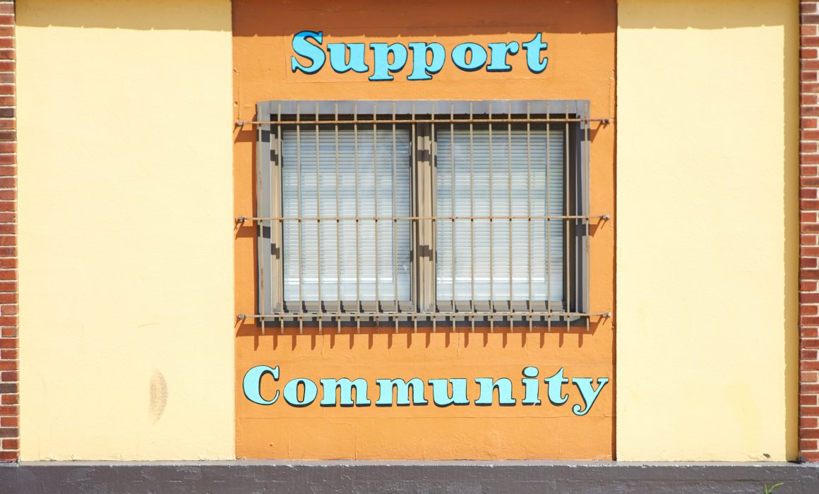 a building with the words support community