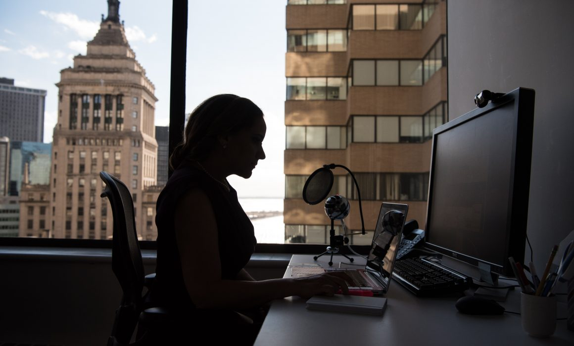 Silhouette of a woman working in an office